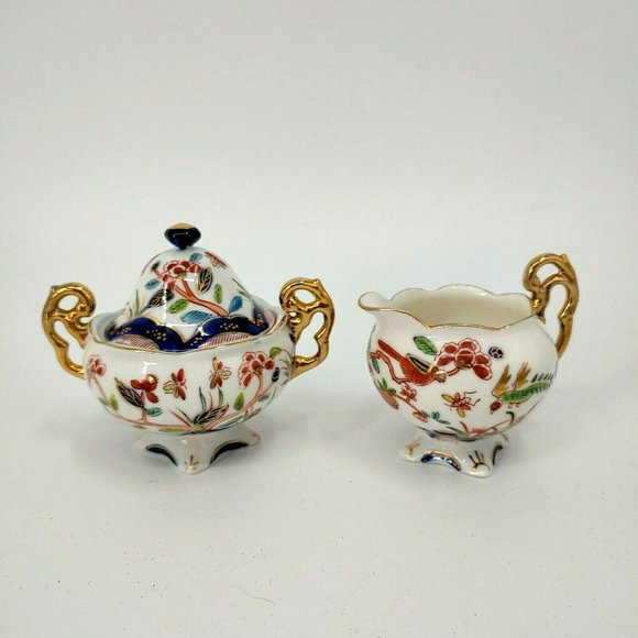 vintage hand painted creamer and sugar set made in